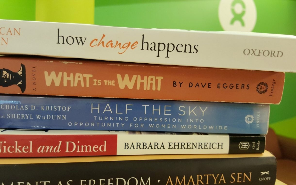 Just a few of the books we're currently reading. Photo: Oxfam America