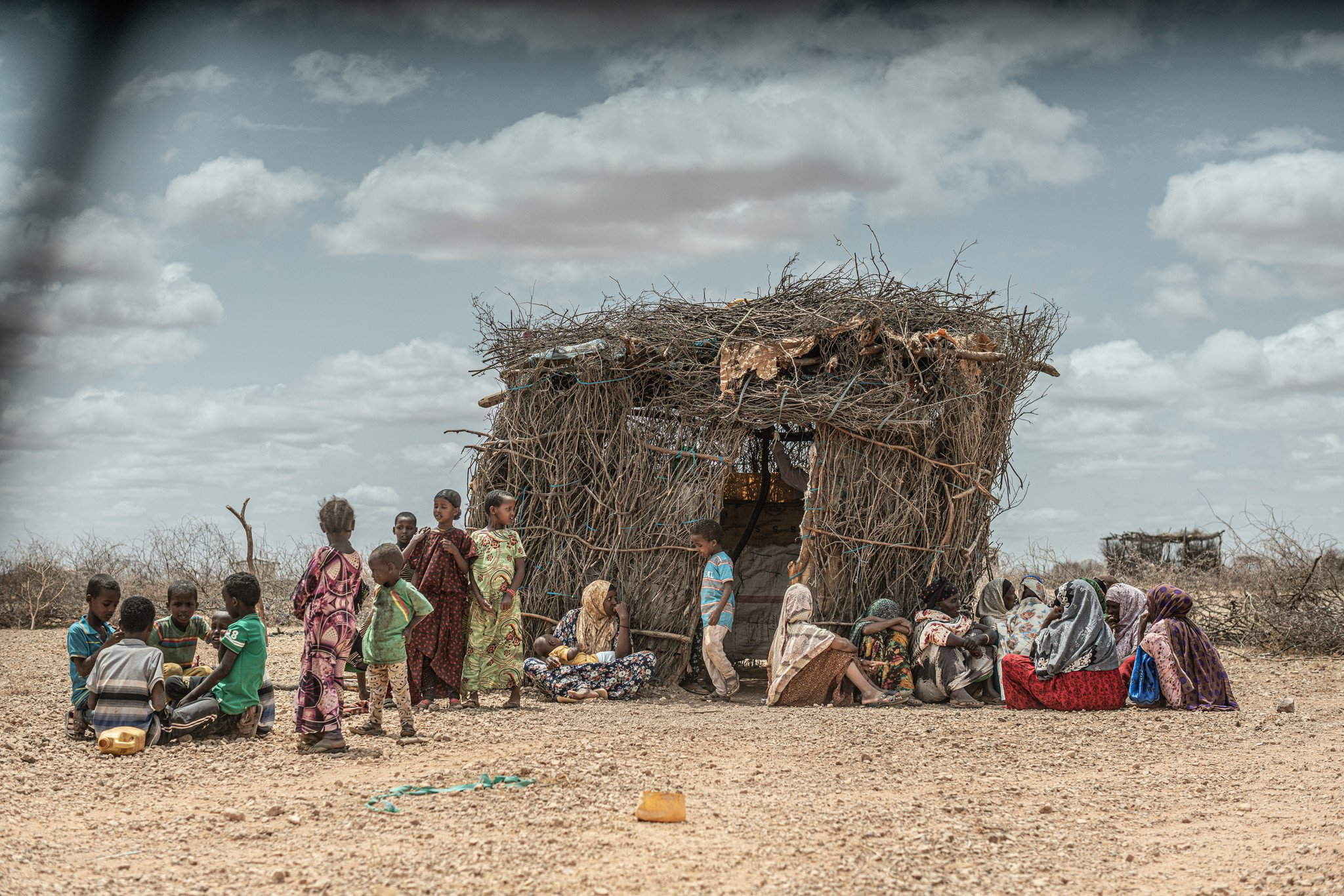 Children in front of a straw hut