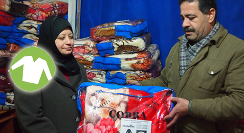 Yasmin Milhim and her husband receiving blankets in Lebanon