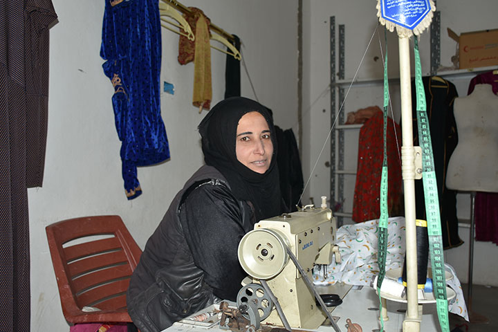 Syrian dressmaker returns to her livelihood