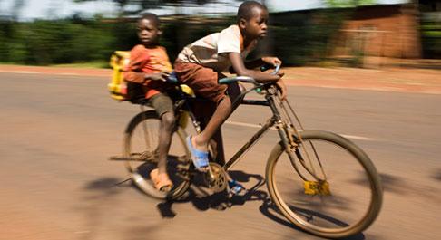 Boys cycling, Rwanda