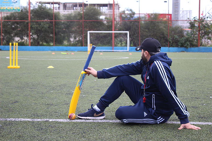 Syrian refugee works as a football coach