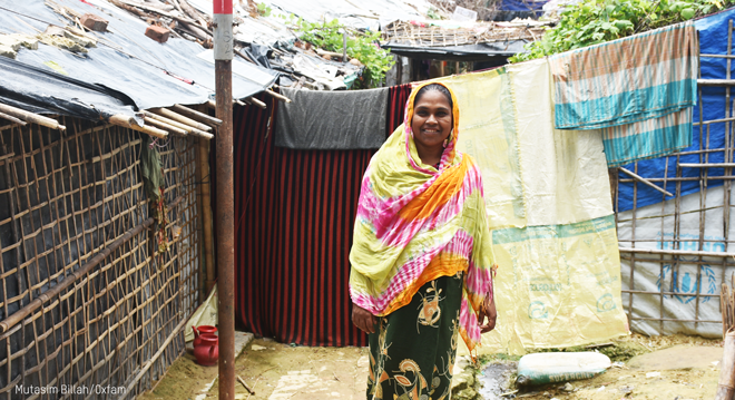 Smiling woman near her unstable home