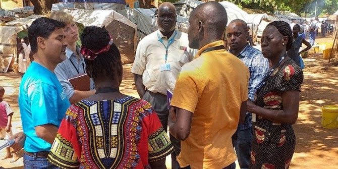 Margaret conversing with partners during a visit to IDP camps in Wau, South Sudan