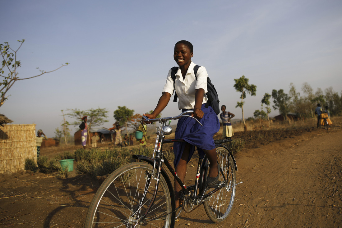 Young Grace on her new Oxfam bicycle. Photo: Corinna Kern/Oxfam
