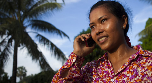 Som Phalla on her Oxfam phone