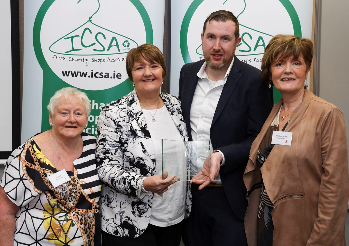 charity shop manager of the year award winner and friends