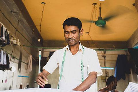 Man tailors clothes