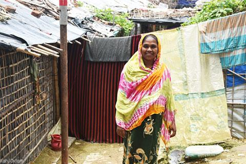 Smiling woman in front of her shelter