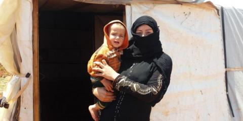 Warda, with her child Jaafar in Lebanon
